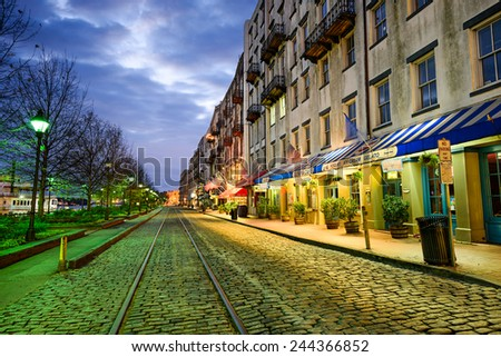 SAVANNAH, GEORGIA - JANUARY 10, 2015: Shops and restaurants line River Street. The historic street is the center of nightlife in the city. - stock photo