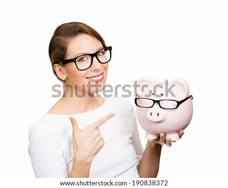 Save money. Closeup portrait happy business woman in glasses, employee, optician, holding piggy bank, giving thumbs up isolated white background. Financial concept. Positive face expressions, emotion