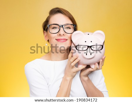 Save money on frames. Closeup portrait, headshot young happy, smiling  business woman, doctor. Buying eyewear opportunity. Piggy bank wearing glasses isolated yellow background. Facial expressions