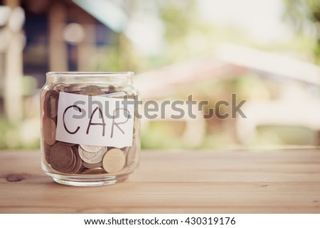 save money.save money concept.save money in glass money jar with car label. - stock photo