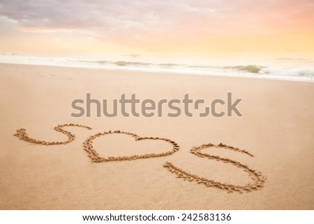 Save our souls - written in the beach sand with heart instead of O. - stock photo