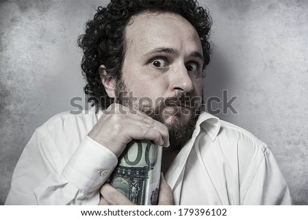 Save, stingy businessman, saving money, man in white shirt with funny expressions - stock photo
