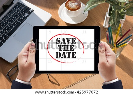 SAVE THE DATE  Businessman work  on tablet on screen - stock photo