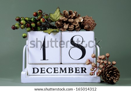 Save the Date calendar with Winter theme colors, fruit and flowers, for birthdays, special occasions, holidays, weddings, website events, or Christmas Advent calendar days, for December 18. - stock photo