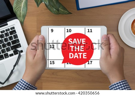 SAVE THE DATE man hand Tablet and coffee cup - stock photo