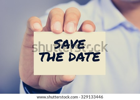 SAVE THE DATE message on the card shown by a man, vintage tone - stock photo