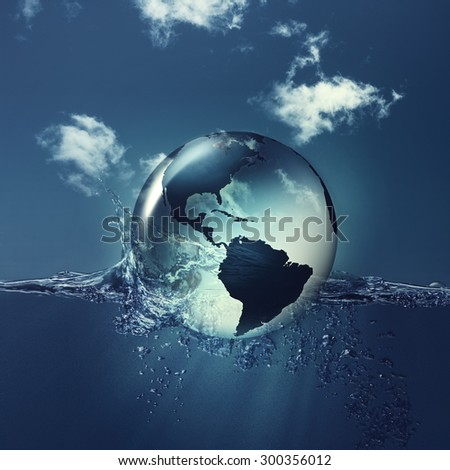 Save the planet. Earth globe on the water waves, abstract natural backgrounds - stock photo
