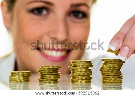 save woman with stack of coins when money - stock photo