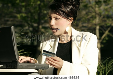 Save your legs girls!  A woman makes an online purchase, online banking,online trading,  billpay - stock photo