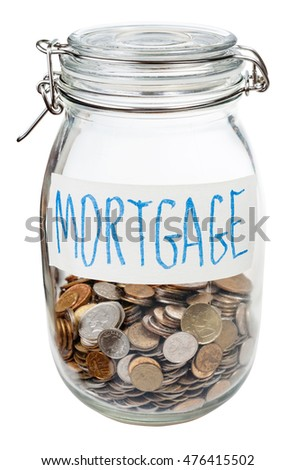 saved coins for mortgage in closed glass jar isolated on white background