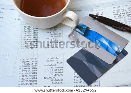 Saving account from bank and Credit card with pencil for financial and loan and a cup of coffee - stock photo