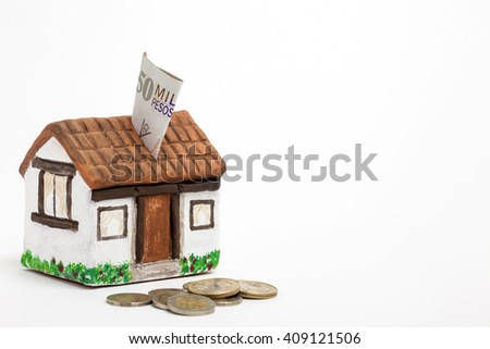 Saving colombian money for a new house -  side view - stock photo