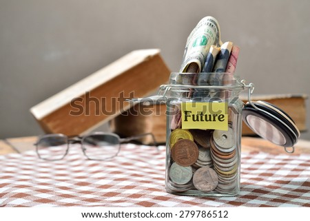 Saving concept for future: Conceptual by jar with coin - stock photo