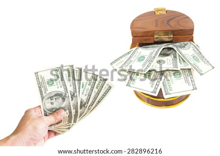 Saving concept : Money dollars in hand collect in wooden chest - stock photo
