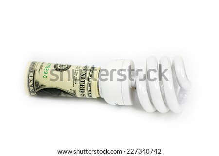 saving energy lamp and paper bill dollar - stock photo