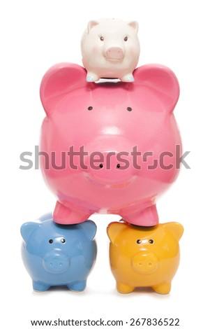 saving for the future piggy banks cutout - stock photo