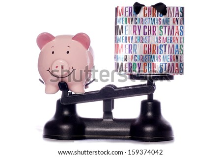 Saving money at christmas studio cutout - stock photo