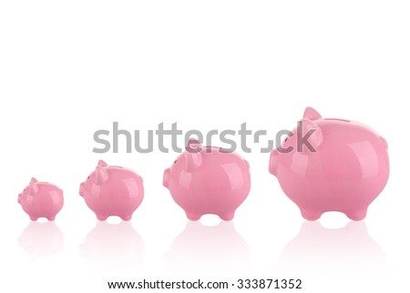Saving money concept - Growing savings . Different sizes of piggy banks.