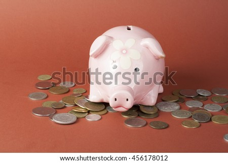 Saving money concept, Many coin and Piggy Bank - stock photo