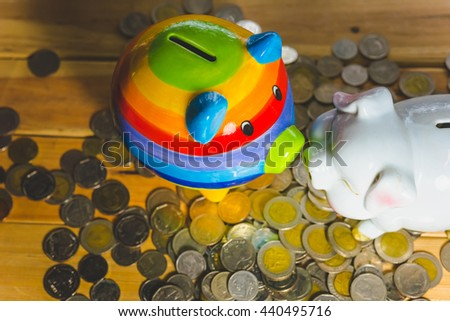 Saving money concept, Many coin and Piggy Bank. Save money with stack money coin for growing your business. Piggy bank on a pile of coins. - Vintage tone. - stock photo