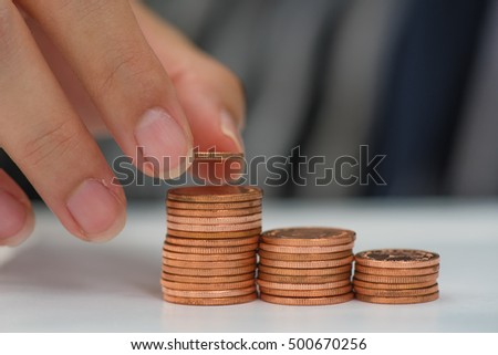 Saving money concept preset by Male hand putting money coin stack growing business