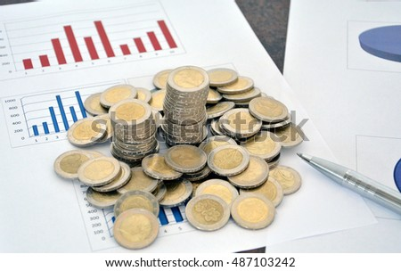 Saving money concept, stacks of coins ,chart and pen. Euro coins.