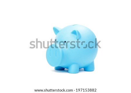 Saving money, hand putting coin into piggy bank - stock photo