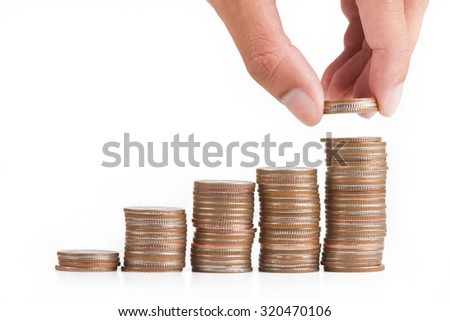 Saving money. Hand putting Coin make business growing. - stock photo