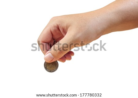 Saving money, hand putting coin on white background - stock photo