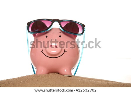 Saving money on your summer holiday piggy banks cutout - stock photo