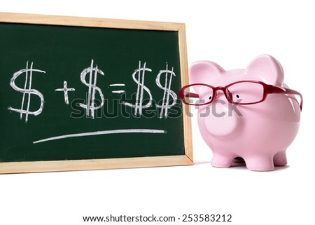 Saving plan : piggy bank, glasses, growth concept. - stock photo
