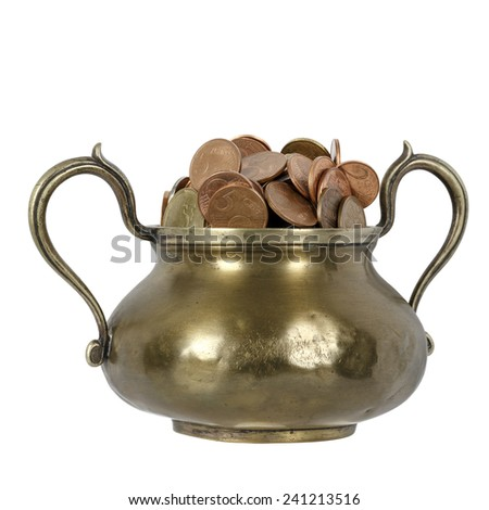 Savings are collected in a brass goblet - stock photo