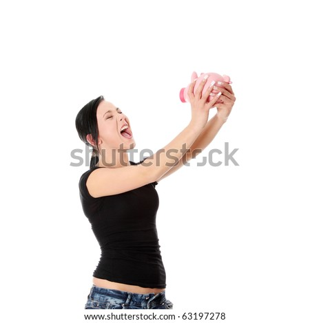 Savings concept - a woman with a piggy bank - isolated over white - stock photo