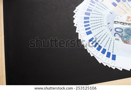 savings concept with european money on black board with copy space - stock photo