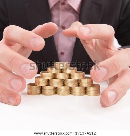 Savings. Hands grabbing stacks of coins. - stock photo