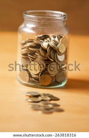 Savings in a jar. - stock photo