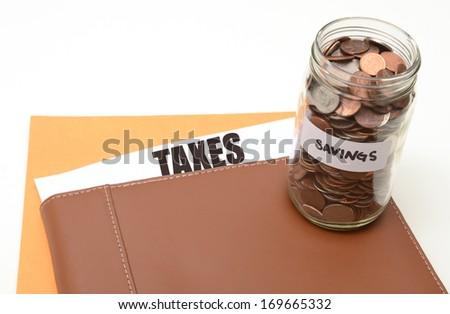 savings on taxes or annual tax bill savings concept - stock photo
