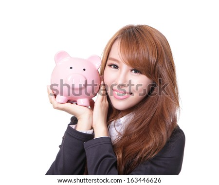 Savings woman smiling happy and holding pink piggy bank isolated on white background. Asian girl - stock photo