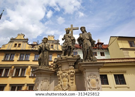 Savior and holy Cosmas and Damian statue on the Charles Bridge in Prague - stock photo