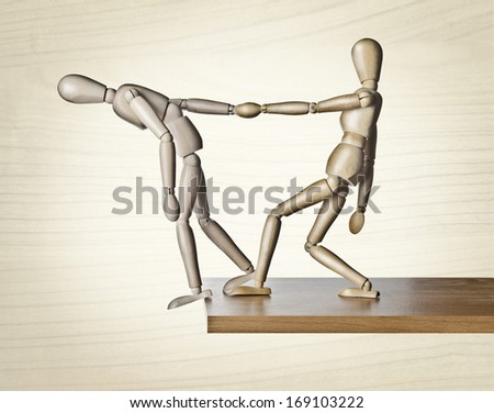 Savior. Two manikins, anatomical model, placed on the edge of a board. - stock photo