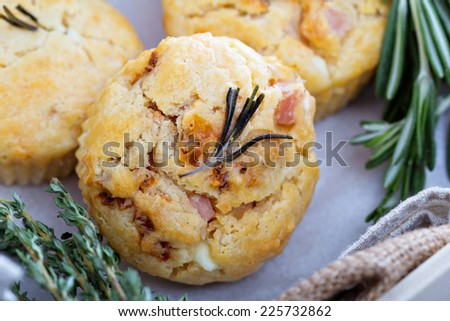 Savory muffins with herbs, tomatoes, feta cheese and ham - stock photo