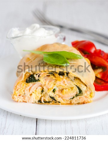 Savory strudel with salmon and spinach, selective focus - stock photo
