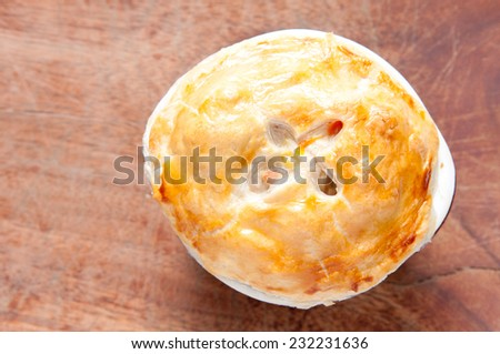 savoury turkey pot pie with flaky pasty top - stock photo