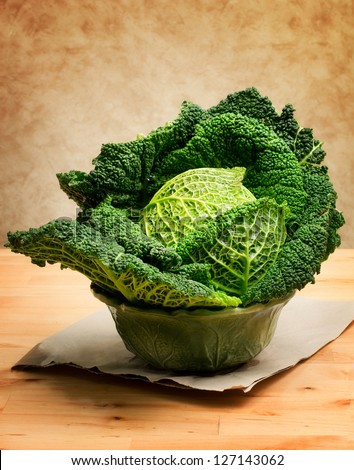 savoy cabbage inside cabbage shape bowl