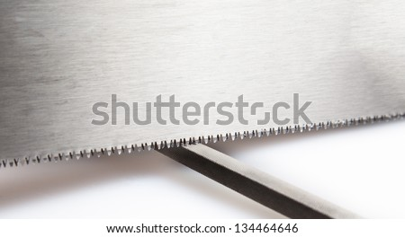 Saw being sharpened by file