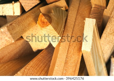 Saw blade and sawdust shot on grainy pine - stock photo