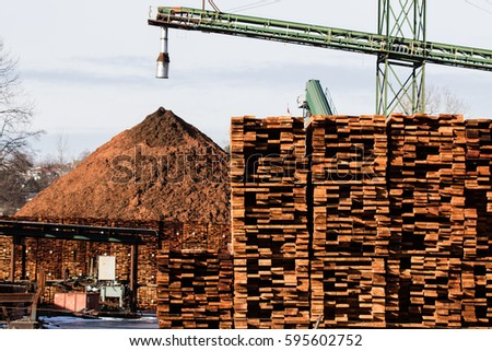 Saw mill products. stacks of freshly cut lumber.