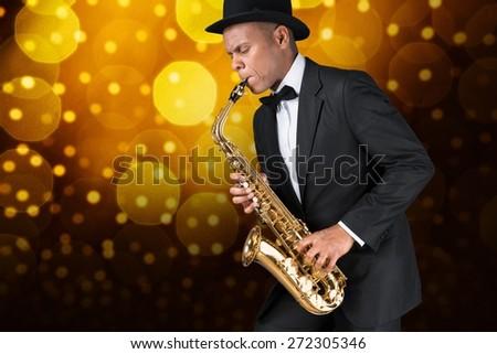 Sax. Black american jazz saxophone player. Vintage. Studio shot. - stock photo