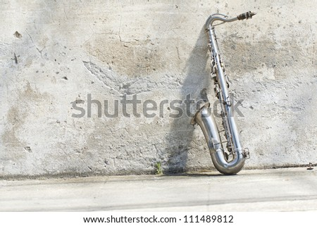sax in front of a vintage wall - stock photo