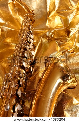 saxophone on gold material - stock photo
